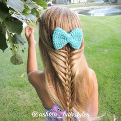Waterfall loop braid. Ashton is wearing a fun crocheted bow by delphaniemariebows from instagram.