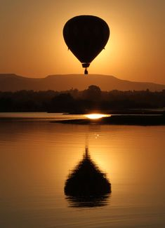 ride in a hot air balloon. I'm totally terrified to do it but I am fascinated with those things.