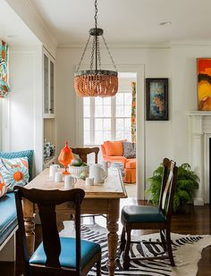 Lana Chandelier - Apricot - Currey & Company | Clayton Gray Home | orange citrus colors with tones of azure blue for open concept white dining/living room