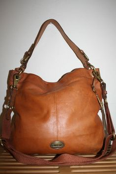 I've been eyeing this gorgeous leather fossil bag for months. I should just take the plunge and make this my big fall/winter purchase!