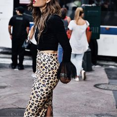 Stand out with a lean, mean leopard-print skirt and a black cropped XXL sleeve top #AsSeenOnMe