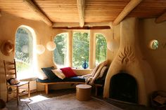 Cob house livingroom. Some day me and my husband will be building our Earthen home.