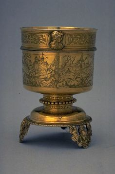Cup with Hare hunting scene. Has three feet, with hunting scenes, ornaments and busts in medallions, with lion knob. Silver reared (goldsmith technique), engraved, cast, gold-plated, ca. 1575.