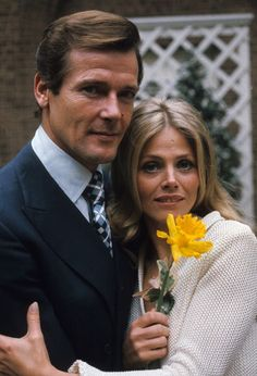 Roger Moore and Britt Ekland pose on location for the filming of James Bond film 'The Man With The Golden Gun' on April 1, 1974 in London, England. (Photo by Anwar Hussein/Getty Images)