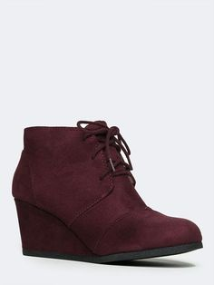 - An ode to classics: your traditional Oxford ankle boot is renewed with a covered wedge and streamlined shape. - Wedge booties lace up at the vamp and stitch panel detailing. - Non-skid sole and cush