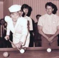 Picture, playing pool with her brother.