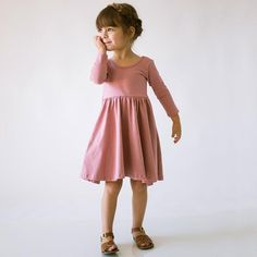 Soft and twirly play dress with a low scoop back, cropped longsleeve, and circle skirt. 95% cotton 5% lycramade in usa