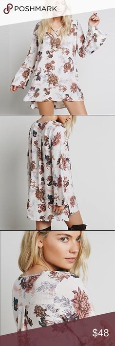 """Heart Beat Printed Tunic DRESS Longsleeve BRAND NEW!! Swingy printed tunic with strappy V-neck and bell sleeves. Pls note: this is an austin gal boutique item. Similar style by Free People.   S: Bust: 41.8""""/Length: 32.7"""" M: Bust: 43.6""""/Length: 33.1"""" L: Bust: 45.4"""" /Length: 33.4"""""""" XL: Bust: 47.2""""/Length: 33.8""""  Item is Brand New, direct from the Manufacturer, & Sealed in Pkg. Dresses"""