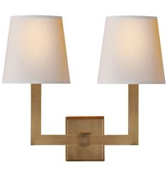 Our Squared Double Sconce features natural paper shades, along with squared-off edges that provide this go-anywhere wall light a clean, modern look.  * Available in Bronze, Antique Brass and Polished Nickel * Solid brass and natural paper * For indoor use * Candelabra sockets * Imported