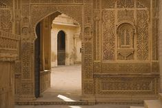 Beautifully intricately and artistically architectured designed and carved wall with an arched entrance in a palace made of sandstone known as Mandir Palace and a tourist attraction in the golden city of Jaisalmer Rajasthan India Jaisalmer, Carving, Explore, Fine Art, Muslim, Indian, Home Decor, Decoration Home, Room Decor