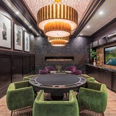 """@faulknerdesigngroup posted on their Instagram profile: """"Extravagant drum chandeliers and a cozy, modern fireplace take this luxury property's poker room to…"""" Drum Chandelier, Chandeliers, Modern Fireplace, Farm House, Game Room, Poker, Profile, Cozy, Luxury"""