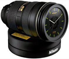 Nikon's lens alarm clock wakes you up to the D4 shutter sound! This is so cool!