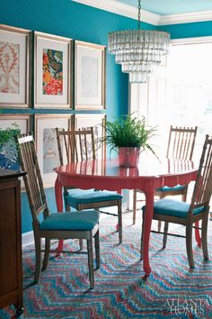 i love everything about this space: the low-hanging placement of the framed wallpaper swatches, the golden chairs, the fern centerpiece, the chandelier, the deep turquoise walls, the contrasting coral table, the flamestitch FLOR tile, and the sky blue ceiling overhead