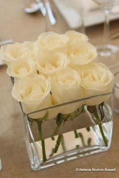 The perfect wedding centerpiece — Dollar Store square vases with 9 white roses each. Lauren, this will be gorgeous on those dark wine tablecloths you picked out. The perfect wedding… Mod Wedding, Wedding Reception, Reception Ideas, Trendy Wedding, Elegant Wedding, Wedding Simple, Wedding White, Wedding Pins, Wedding 2015