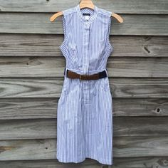 Blue and white striped shirt dress Blue and white striped shirt dress. Hidden buttons. Side pockets. Elastic belt included. 14 inches armhole to armhole. 36 inches shoulder to hem. Excellent condition. Venus Dresses Midi