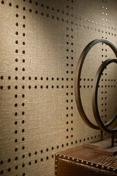 rivet wall covering Upholstery nails and fabric! I would like this in cupboard.