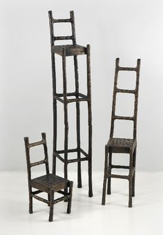 31.00 SALE PRICE! These quirky, bistro-style chairs uniquely hold table numbers, small signs, or photos. Use the Iron Chair Sculptures to display pictures, s...