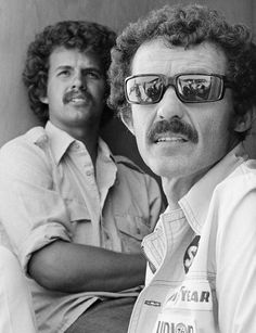 Richard Petty, front,  and son Kyle relax by their trailer early Monday, July 2, 1979 in Daytona Beach, Florida as qualifications continue for the July 4th firecracker 400 race at the Daytona International speedway.