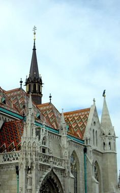 Matthias Church, Budapest. Dominant neogothic church crowning Budapest's cityscape - nowadays is under reconstruction. The church praises a wonderful and unusual roof made of coloured shingles and elegant pinnacles. The interior worth a visit because of the frescoes and the artistic glass walls.