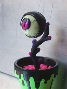 Persephone the Eyeball Plant by OpticAnomalies on Etsy. Reminds me of the super old Maniac Mansion NES game for some reason.