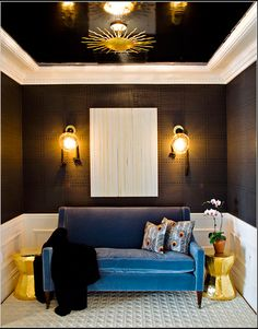 blue velvet couch with black white and yellow