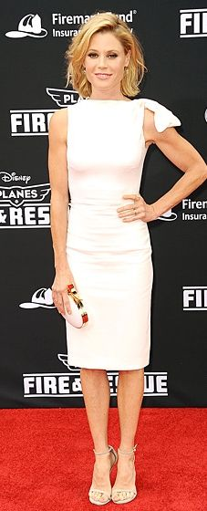 Julie Bowen stunned in a white Dsquared2 sheath with a bow on the shoulder, paired with Stuart Weitzman sandals.