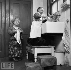 October 26, 1956  Henry Behrens, the then smallest man in the world stands on a table to wash dishes in his Worthing home. Measuring only 30 inches high, Mr Behrens made a living by travelling the world with Burton Lester's midget troupe.  (via LIFE)