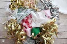 Learn how to make the prettiest bridal shower bow bouquet for the wedding rehearsal with paper plates and these simple steps! This bow bouquet is gorgeous! Wedding Rehearsal Bouquet, Bridal Shower Bouquet, Bridal Shower Party, Bridal Shower Decorations, Ribbon Bouquet, Paper Bouquet, Wedding Pins, Wedding 2015, Wedding Ideas