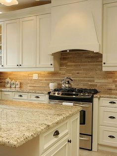 Brown travertine mix kitchen backsplash tile from backsplash.com that's either a New Venetian Gold, a Giallo Ornamental, or a St. Cecilia Granite (all of which look pretty much the same depending on which slab you get).