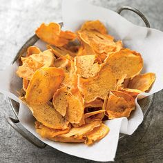 Spiced Sweet Potato Chips by womenshealthmag: Dusted with a blend of sweet and hot seasonings including chili power, cumin, and sugar, these crunchy chips never stay around for long. #Chips #Healthy #Sweet_Potato