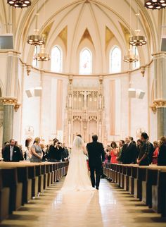 Church of Gesu wedding ceremony in Milwaukee WI. Photo captured on Contax 645 with Fuji 400H film by The McCartneys Photography.