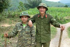 Vietnam. Deforestation. De-mining patrol officer with support soldier