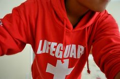 Love lifeguard uniforms <3 I need one of these sweatshirts