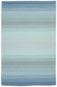 Shades of varying tones of sea aqua and turquoise make up this gorgeous Aqua Ombre Stripes Area Rug, perfectly suited for any spot in your beach home that needs an touch of modern, contemporary design!