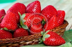 Basket with ripe strawberries; closeup shot.