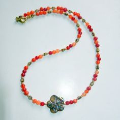Orange Quartz and Brown Hibiscus Beaded Necklace