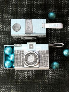 Give them something to smile about! Hand illustrated camera box is letterpress printed with a robins egg blue and soft black. Slidebox opens to hold a