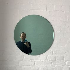 "Delightful crafted green tinted round mirror frameless with a floating effect. Design and hand-crafted in London UK.   Supplied fully fitted with a specialist hanging system for an easy installation.  Also available in:  Small: 40cm/15.8""  Regular: 50cm/19.7""  Medium: 60cm/23.6""  Large: 79cm/31.1""  Extra Large: 100cm/39.4""   or any bespoke dimension; contact us for a quote.  We ship safely worldwide."
