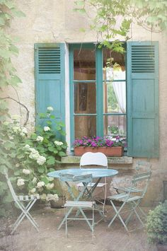 French country photography blue bistro table chairs shutters cottage window wall decor via decorative tiles Outdoor Rooms, Outdoor Gardens, Outdoor Living, Outdoor Decor, Outdoor Fun, French Country Cottage, French Country Style, Country Blue, Country Farmhouse