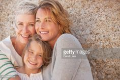 Stock Photo : Three generations of women smiling outdoors
