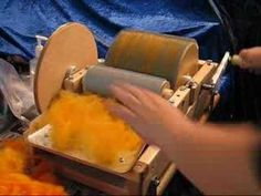 Working on a Drum Carder. good videos..  be sure to have your volume knob or button in reach..  it gets loud at times, then you cant hear when she starts talking again. lots of other carding and spinning videos from her as well..