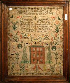 """Catharine Ringwall from 1831. This design is fairly classic: large red house, tall pine trees, birds, saying. It's unusual to see the """"made in"""" statement at the top of the sampler (and so prominent.) The house is handsome, and I love it when the stitchers sneak in as many motifs as possible."""