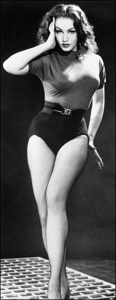 Julie Newmar. S)