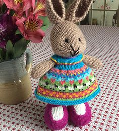 This bunny was made especially for a friend far away. A cast on of 104 stitches was used to create a full skirt. The skirt portion of the dress has 17 repeats of the chart shown in the photos. Row...