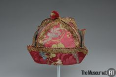 Man's at-home cap, France, 1700-1730. Pink silk damask brocaded with multicoloured floral motifs, metallic lace and cording.