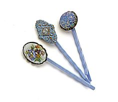 Bobby pin trio, with Victorian and Shabby Chic appeal, perfect for a bride's something blue. One, a vintage Limoges blue/purple/gold/green floral cabochon, is set in vintage lace edge brass. Another, a stunning Victorian brass piece, has been patinaed and buffed for gleaming highlights. There's a dazzling Swarovski crystal chaton at its center. Lastly, there's a lovely vintage Czech glass fire opal, again set in vintage brass.