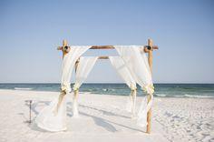 beach ceremony arch designed by White Sand Weddings, photo by photo by aislinnkate.com