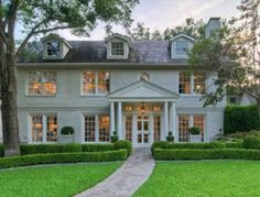 A great, classically inspired home with an abundance of windows.  I think I see a pattern forming here.