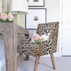 Chic work space boasts a leopard print chair in Tonic Home Bianca Fabric lined with an Eastern Charms Hibiscus Pillow paired with a salvaged wood desk topped with a yellow green lamp. Decor, Furniture, Guest Bedrooms, Home Decor Inspiration, Interior, Home Decor, Bedroom Decor, Interior Design, Printed Chair