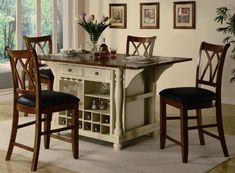 A storage kitchen island and dining table in one with a beautiful buttermilk and cherry kitchen island collection by coaster httpfurniturendecorbuttermilk and cherry kitchen island collection by coaster workwithnaturefo